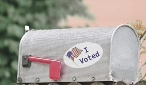 Metal mailbox for rural homes with I Voted sticker as concept